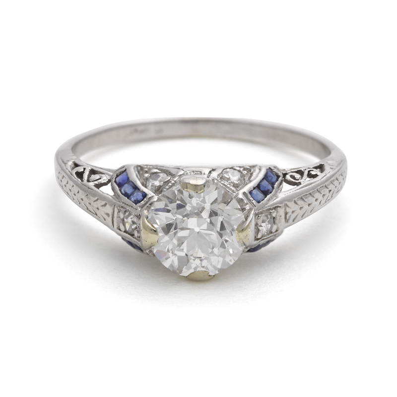 14K white gold, diamond, and sapphire ring, with a
