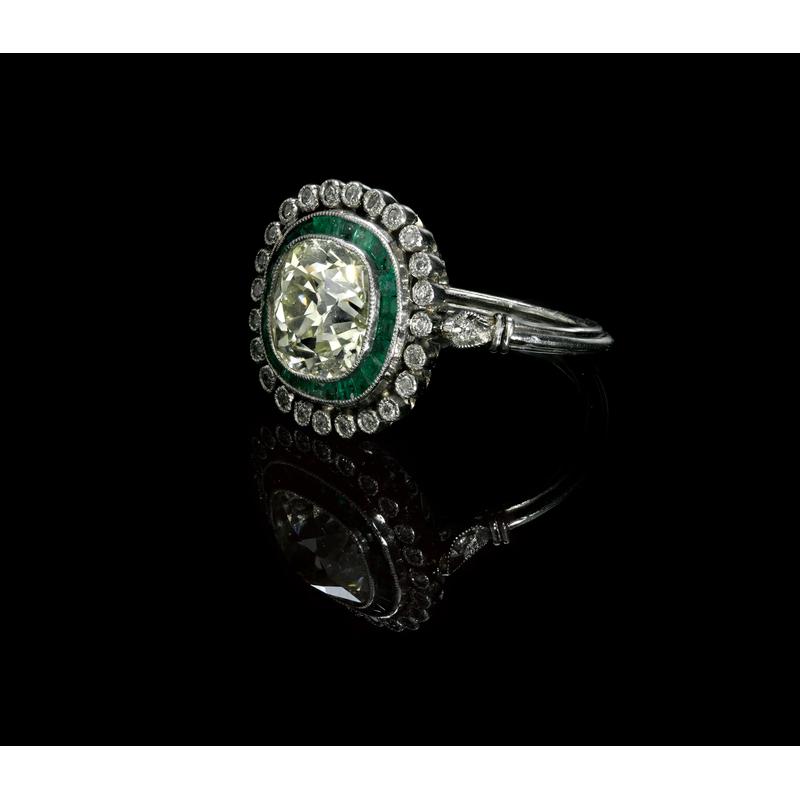 Platinum, emerald, and diamond ring, ca. 1920, wit