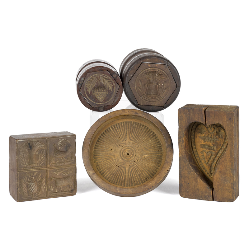 Five carved butterprints, 19th c., to include twoa