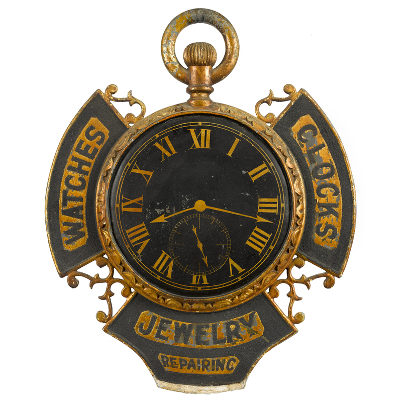 Elaborate painted zinc clock and jewelry trade sig