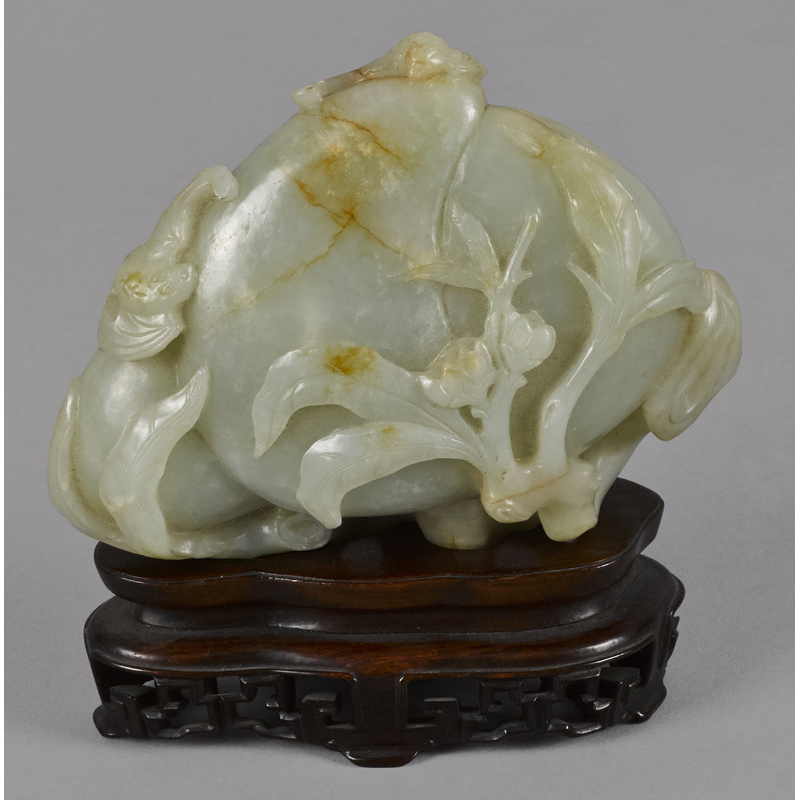 Chinese carved celadon and russet jade gourd