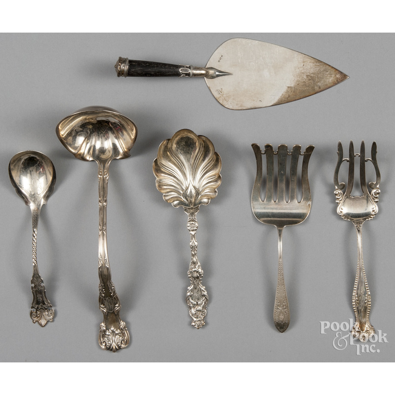 Six sterling and coin silver serving utensils, 23.
