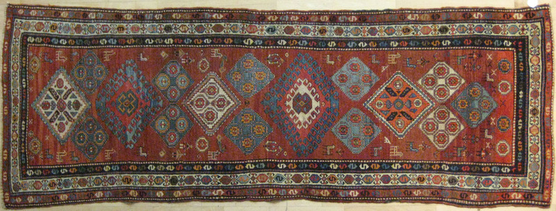 Caucasian runner, early 20th c., with medallions o