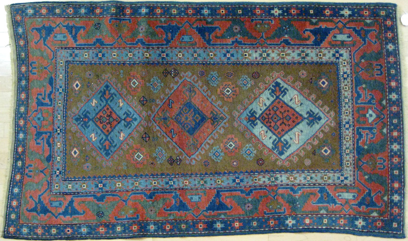 Caucasian carpet, early 20th c., with three medall