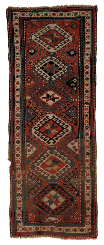 Kazak long rug, ca. 1900, with six medallions on a