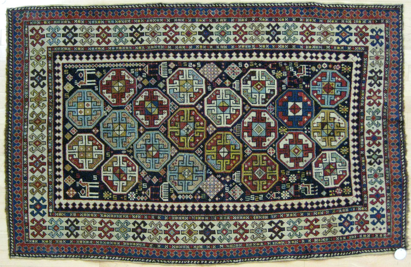 Shirvan carpet, ca. 1900, with repeating medallion