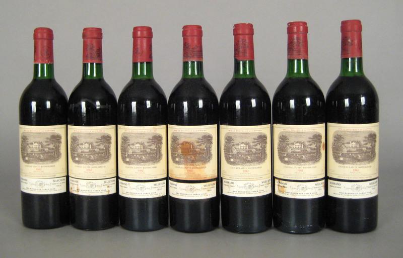 Seven 750ml bottles 1982 Lafite Rothschild.