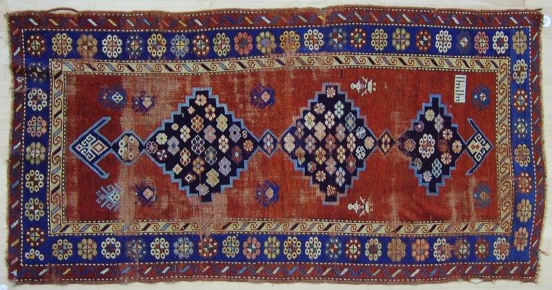 Caucasian throw rug, ca. 1900, 7' x 3'7