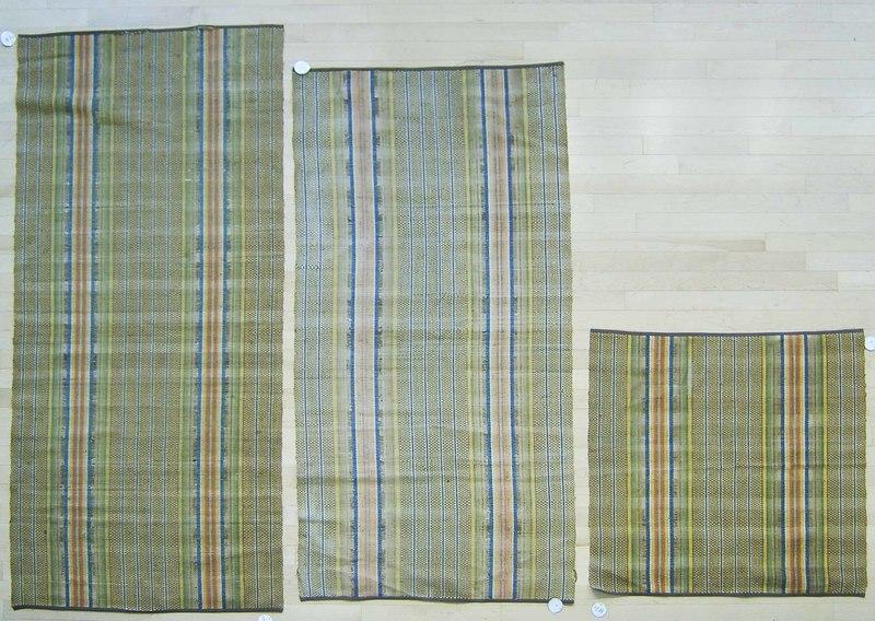 Three rag rugs.