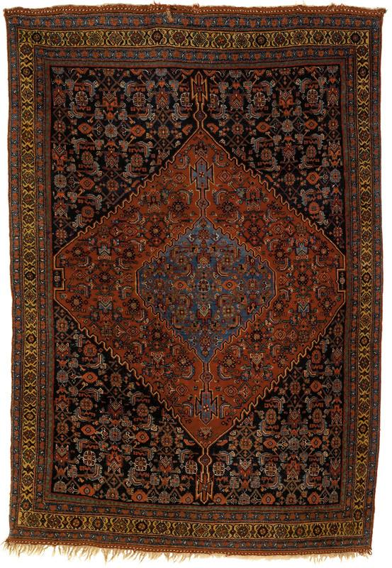 Bidjar throw rug, ca. 1920, with a red medallion o