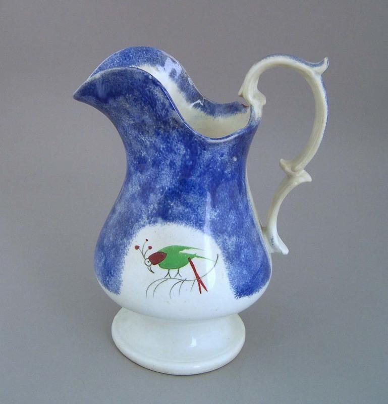 Blue spatter pitcher, 19th c., with parrot decorat