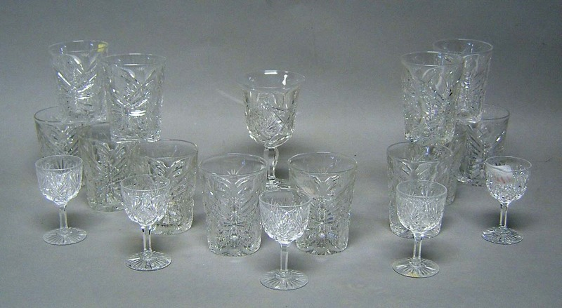 Twelve cut clear glass tumblers in a butterfly and