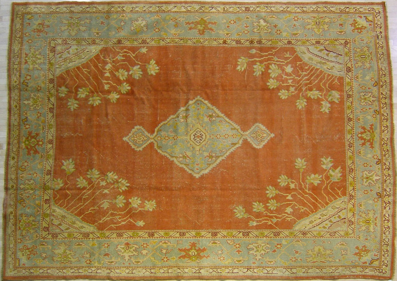 Roomsize Oushak rug, early 20th c., with a central