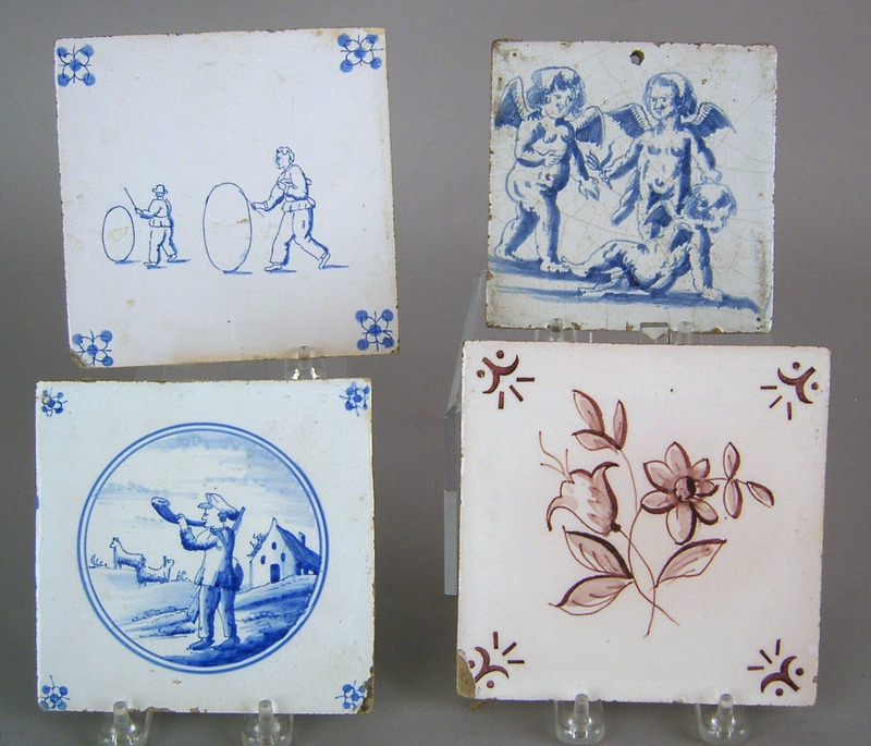 Four Delft tiles, 18th c., depicting cherubs, 2 me