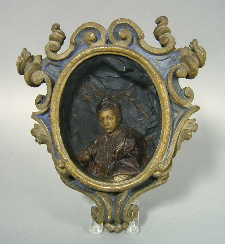 Continental wax reliquary, late 17th c., with carv