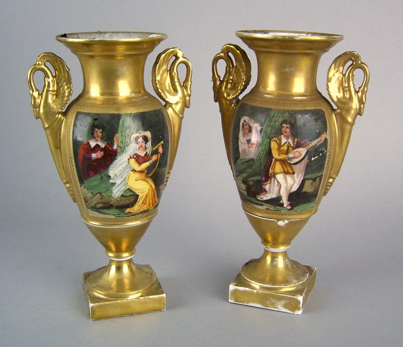 Pair of Paris porcelain urns, 19th c., each wih ha