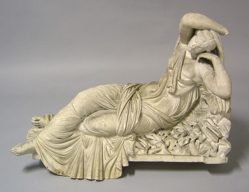 Marble statue, 19th c., of a reclining woman, 23