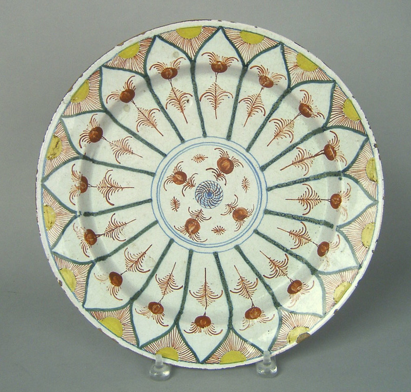 Dutch delft charger, ca. 1735, with green, red, an