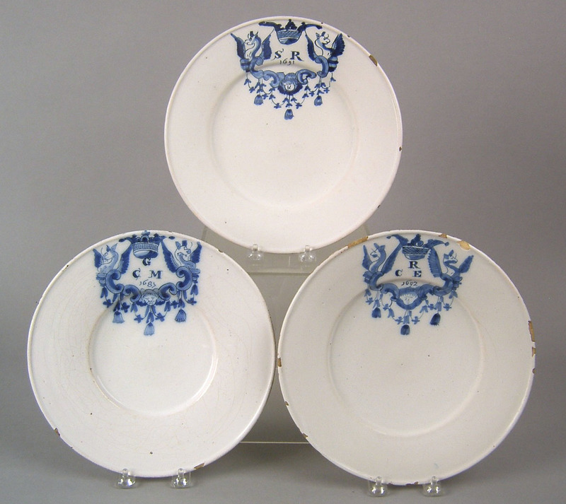Three similar Dutch delft wide rimmed plates dated