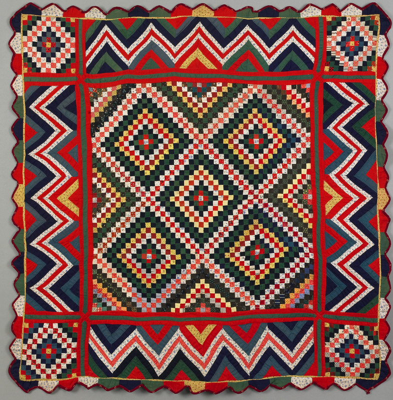 Vibrant Pennsylvania pieced crib quilt, late 19th.