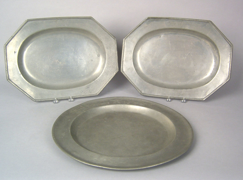 Two English octagonal pewter platters, 19th c., bo