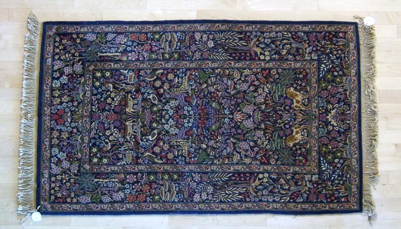 Semi-antique garden throw rug, 5'6