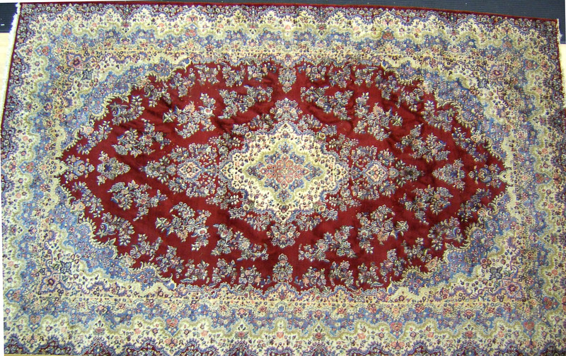 Roomsize Kirman rug, 20' x 13'.
