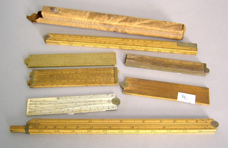 Group of measuring devices, slide rule, yardstick,