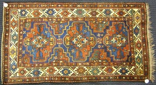 Kurdish Kazak throw rug, ca. 1915, with 3 medallio