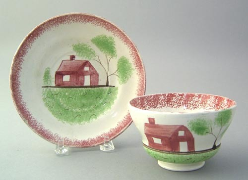 Red spatter cup and saucer with red schoolhouse.