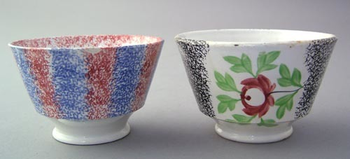 Yellow and black rainbow spatter cup with rose, an