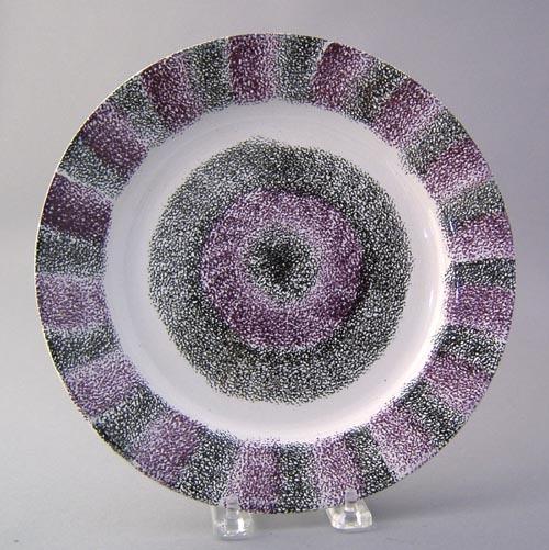 Vibrant black and purple rainbow spatter plate wit