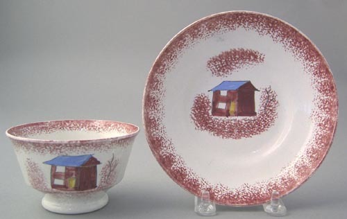 Red spatter handleless cup and saucer with red she