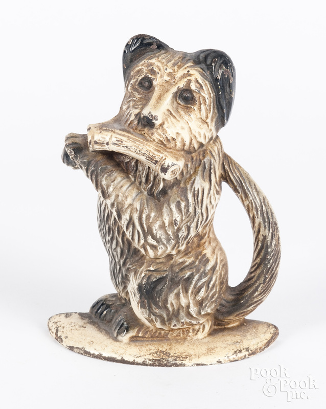 Cast iron begging dog with newspaper doorstop