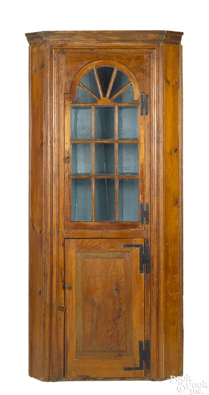 Pine barrelback corner cupboard, late 18th c.