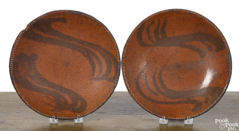 Pair of redware plates, 19th c.