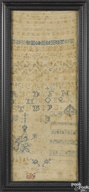 Silk on linen band sampler, dated 1693
