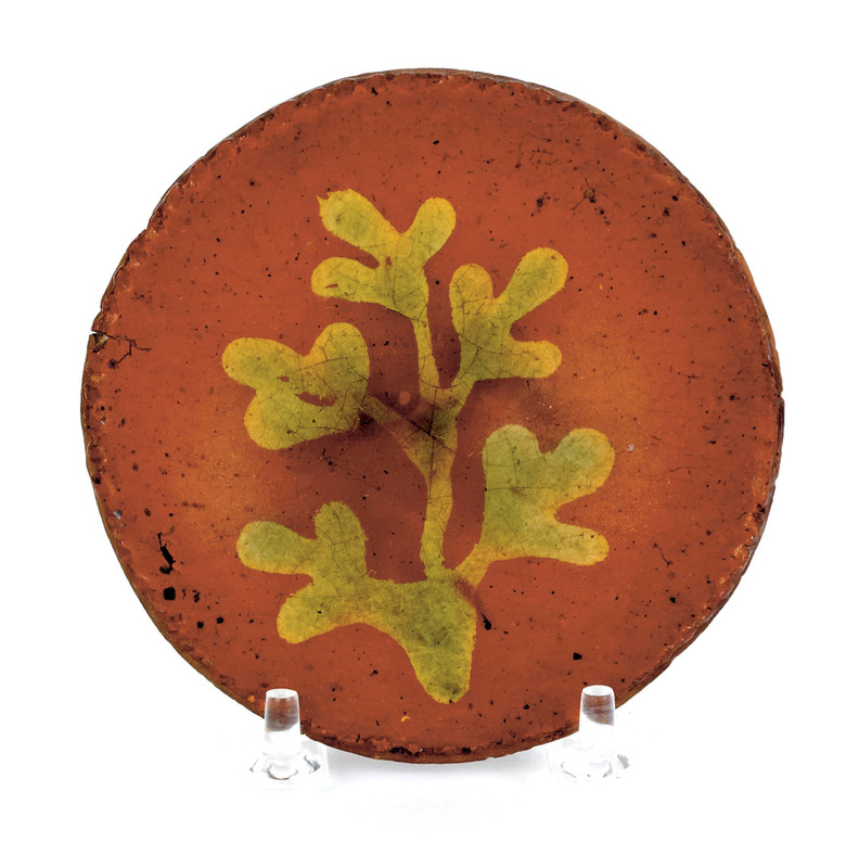 Miniature redware plate, 19th c., with yellow andr