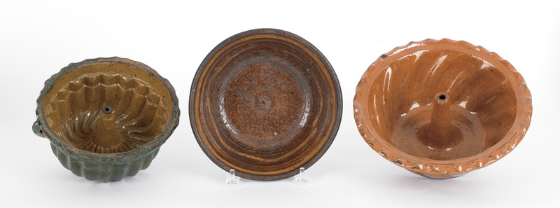 Two redware turk's head molds, 19th c., together w