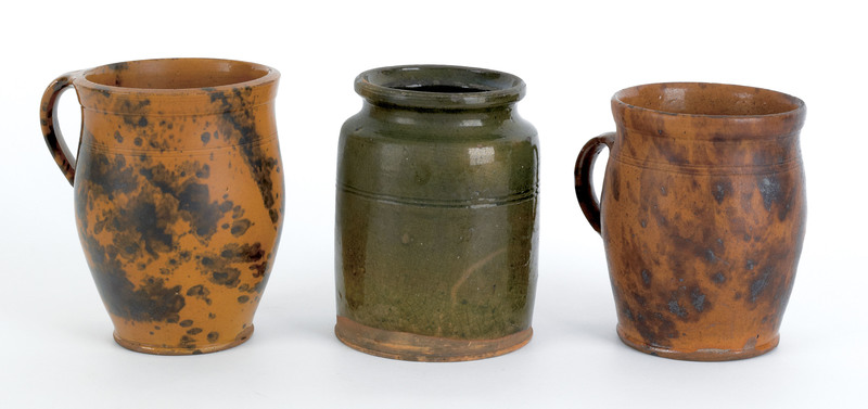 Two redware apple butter crocks, 19th c., with man