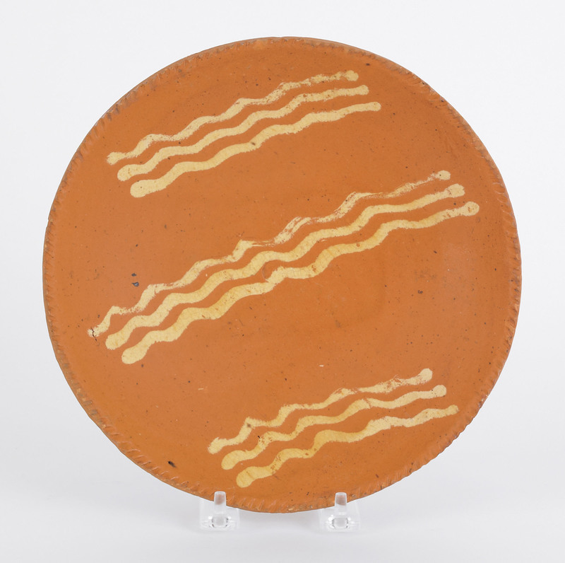 Pennsylvania redware pie plate, 19th c., with yell