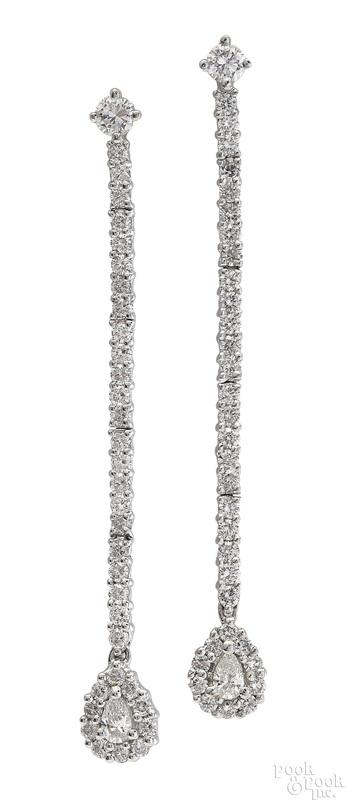 Pair of 18K white gold diamond dangle earrings