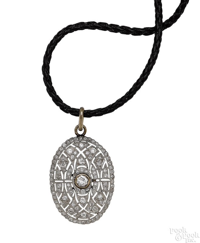 Platinum diamond pendant on a braided leather rope