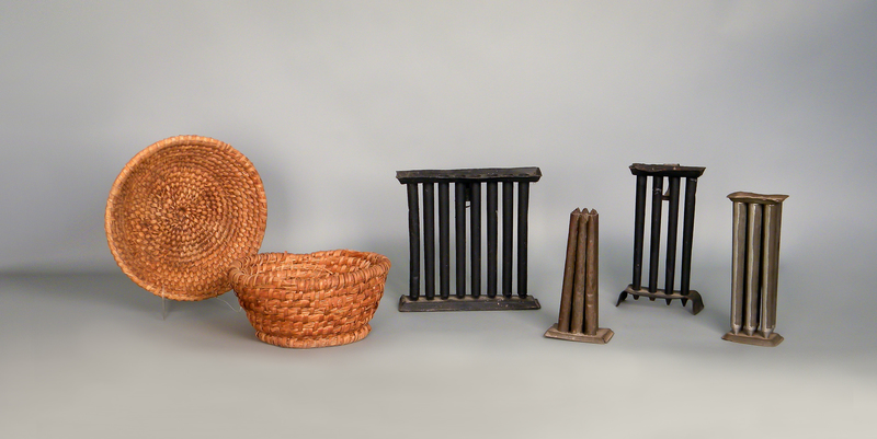 Two rye straw baskets, together with four tin can