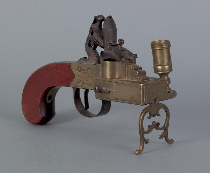 Brass flintlock striker, ca. 1800, inscribed Long