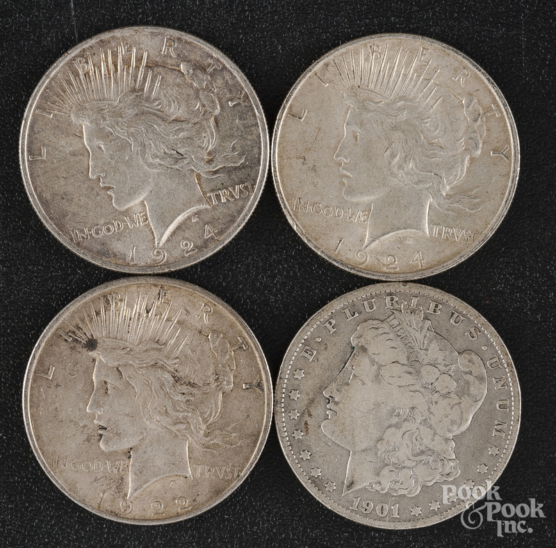 Three Peace silver dollars