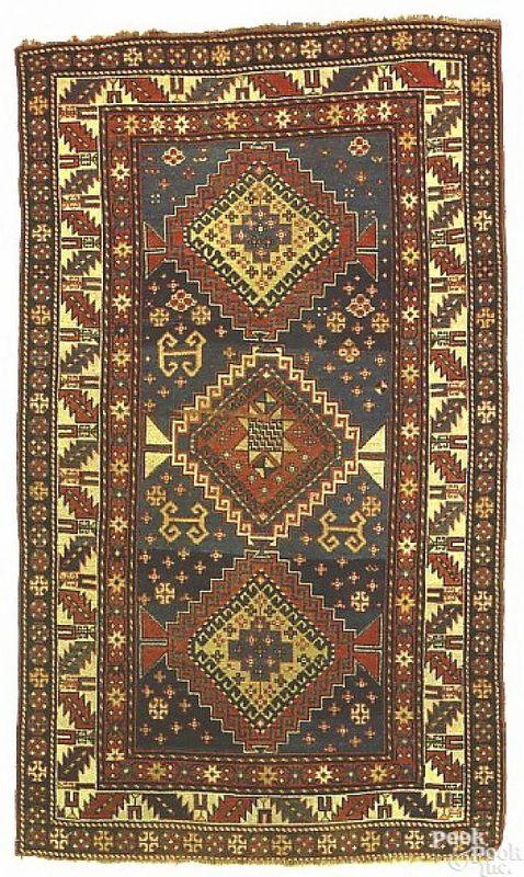 Kazak throw rug, ca. 1900, with 3 central medallio