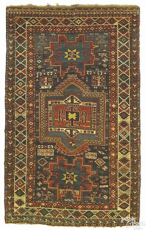 Kazak rug, ca. 1900, with 3 medallions on a blue f