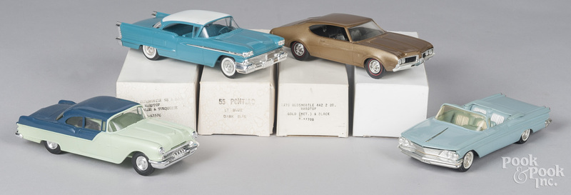 Four plastic promotional vehicles