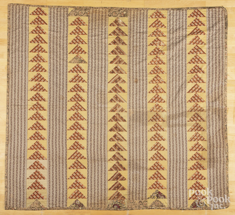 Flying geese quilt with chintz border